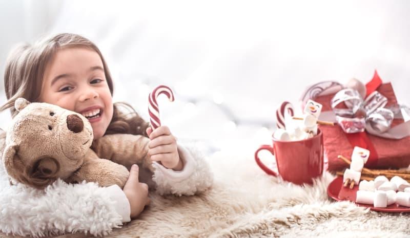 Christmas Little Cute Girl Hugging Teddy Bear