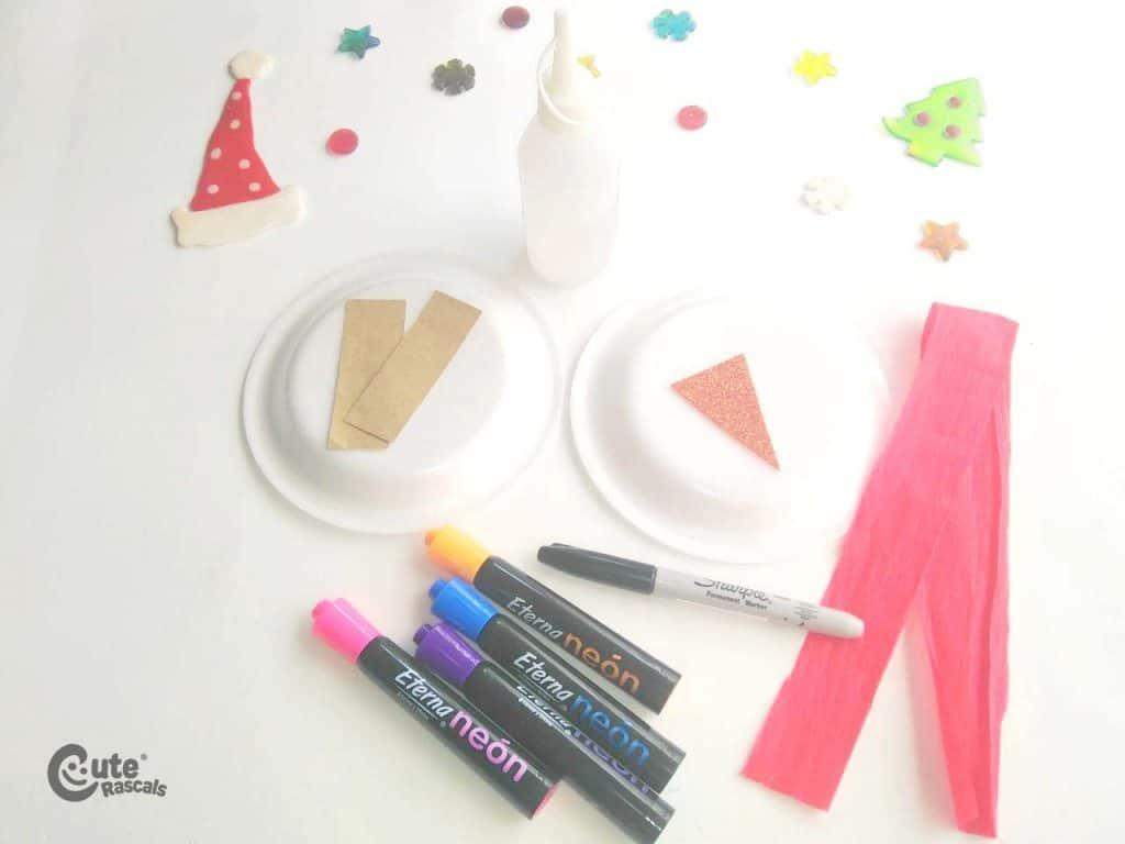 Materials for snowman paper plate art craft for kids