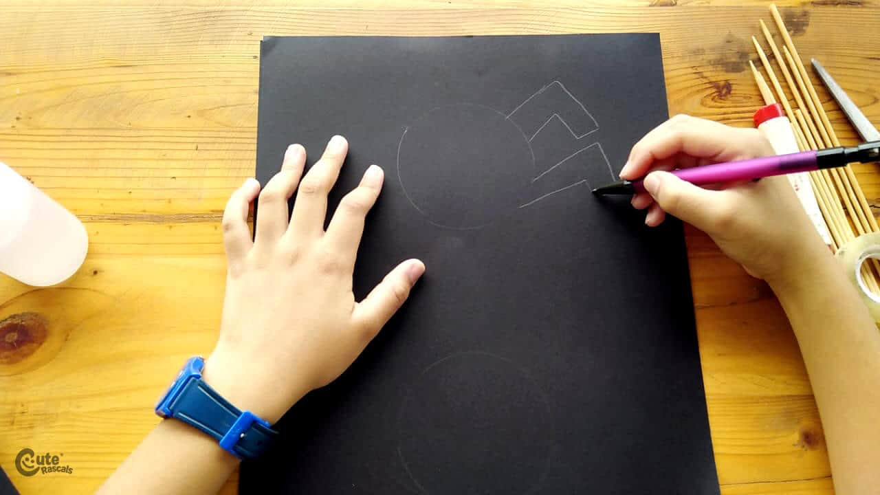 draw some spider on the black cardboard. gross motor games for preschoolers
