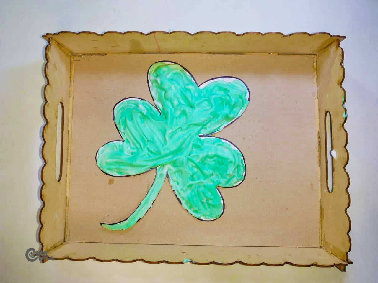 Art ideas for kids! A clover drawing painted with shaving foam.