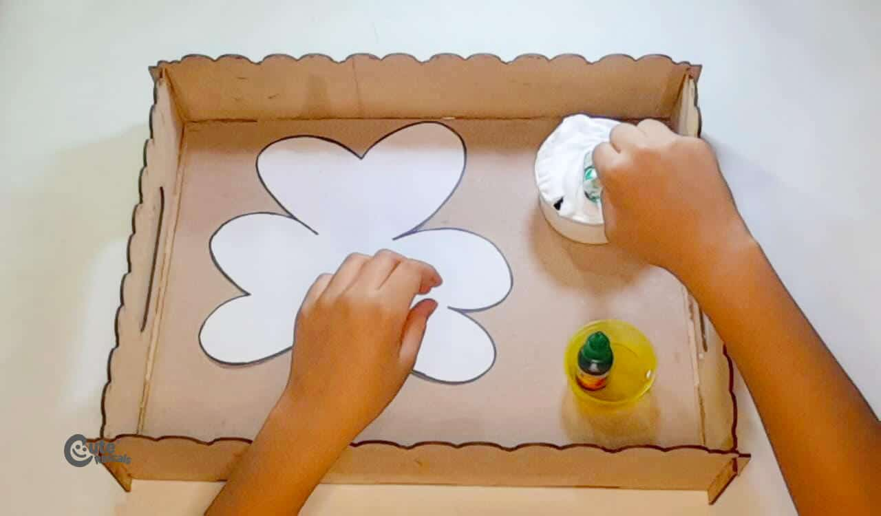 mix the shaving foam with the popsicle stick