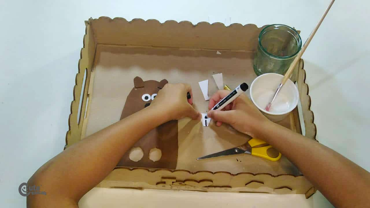 draw the groundhog's teeth in this kids craft