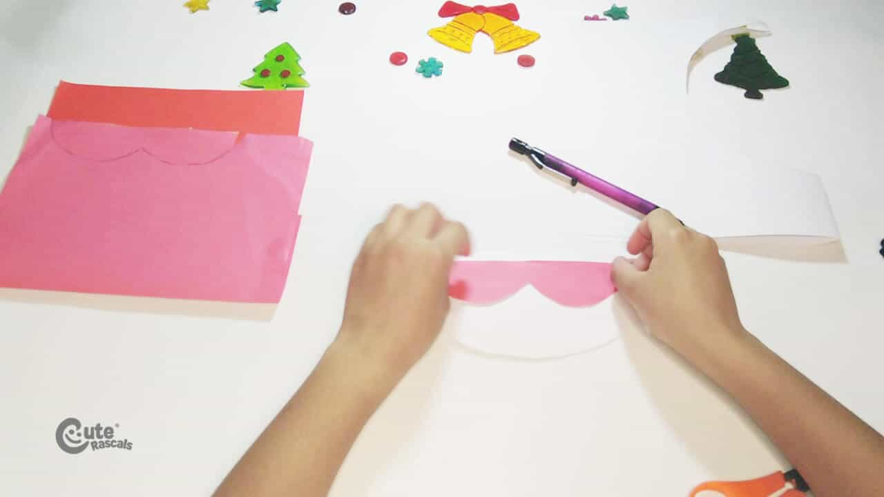 Paste the Santa's face to the semi-circle. Santa Claus craft