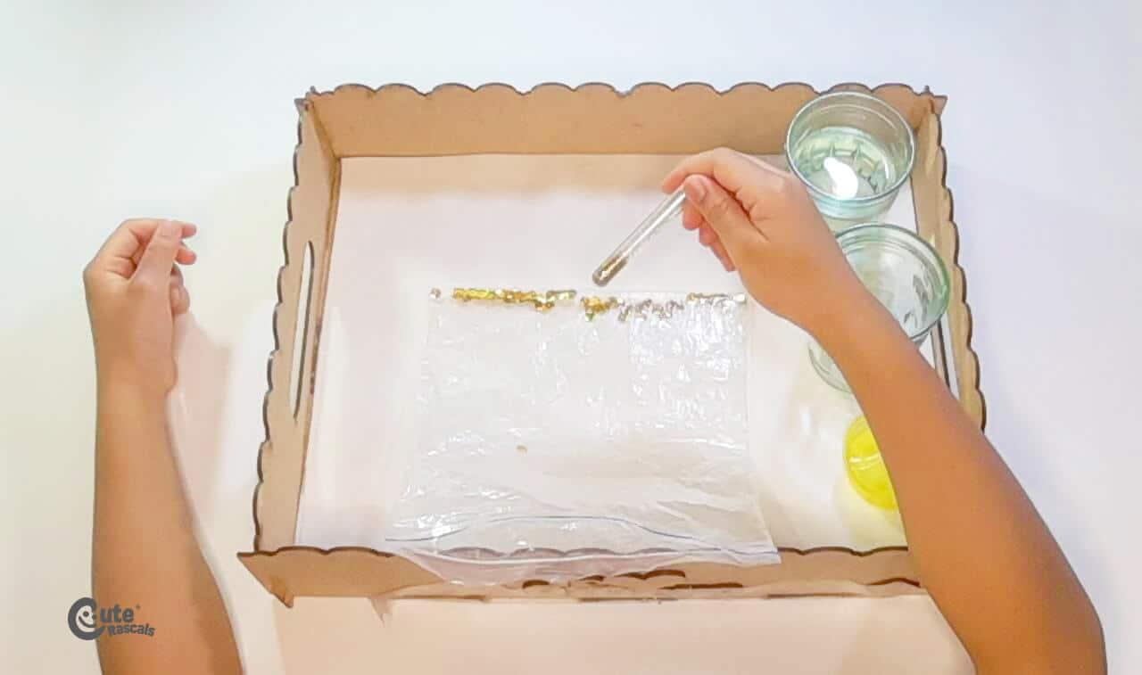 Add the glitter into the Ziploc bag. Easy sensory bag