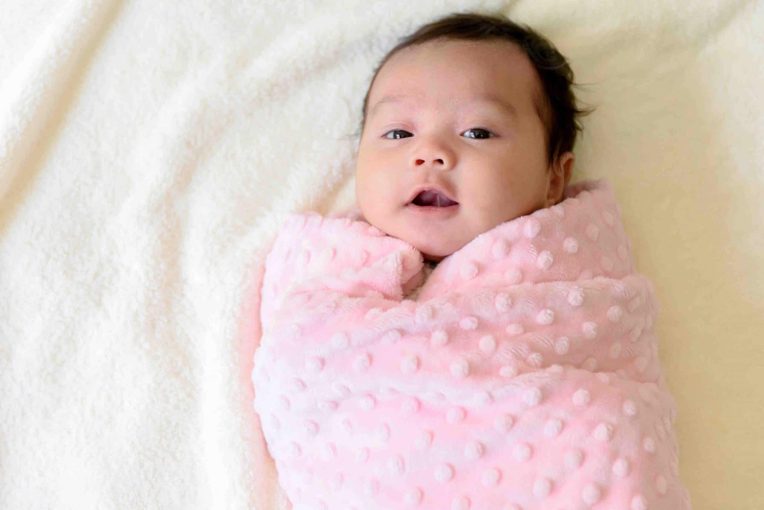 infant on bed