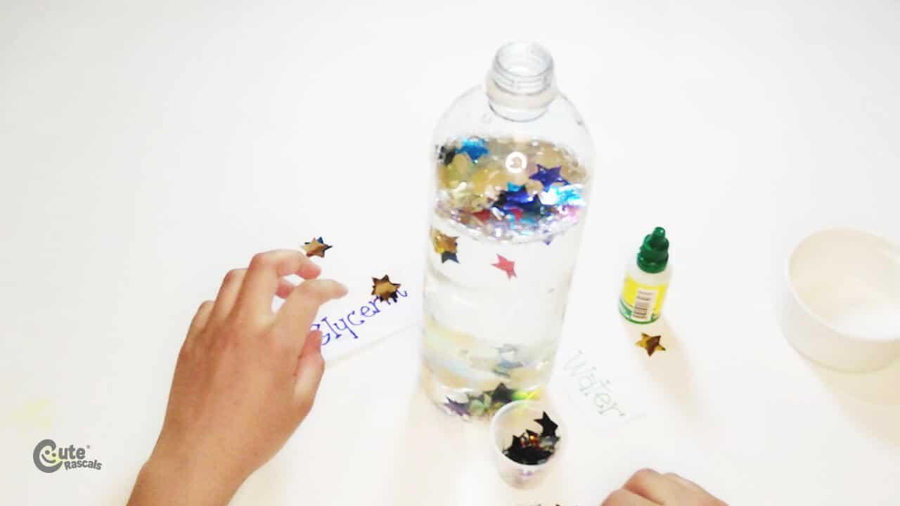 Put the confetti into the plastic bottle