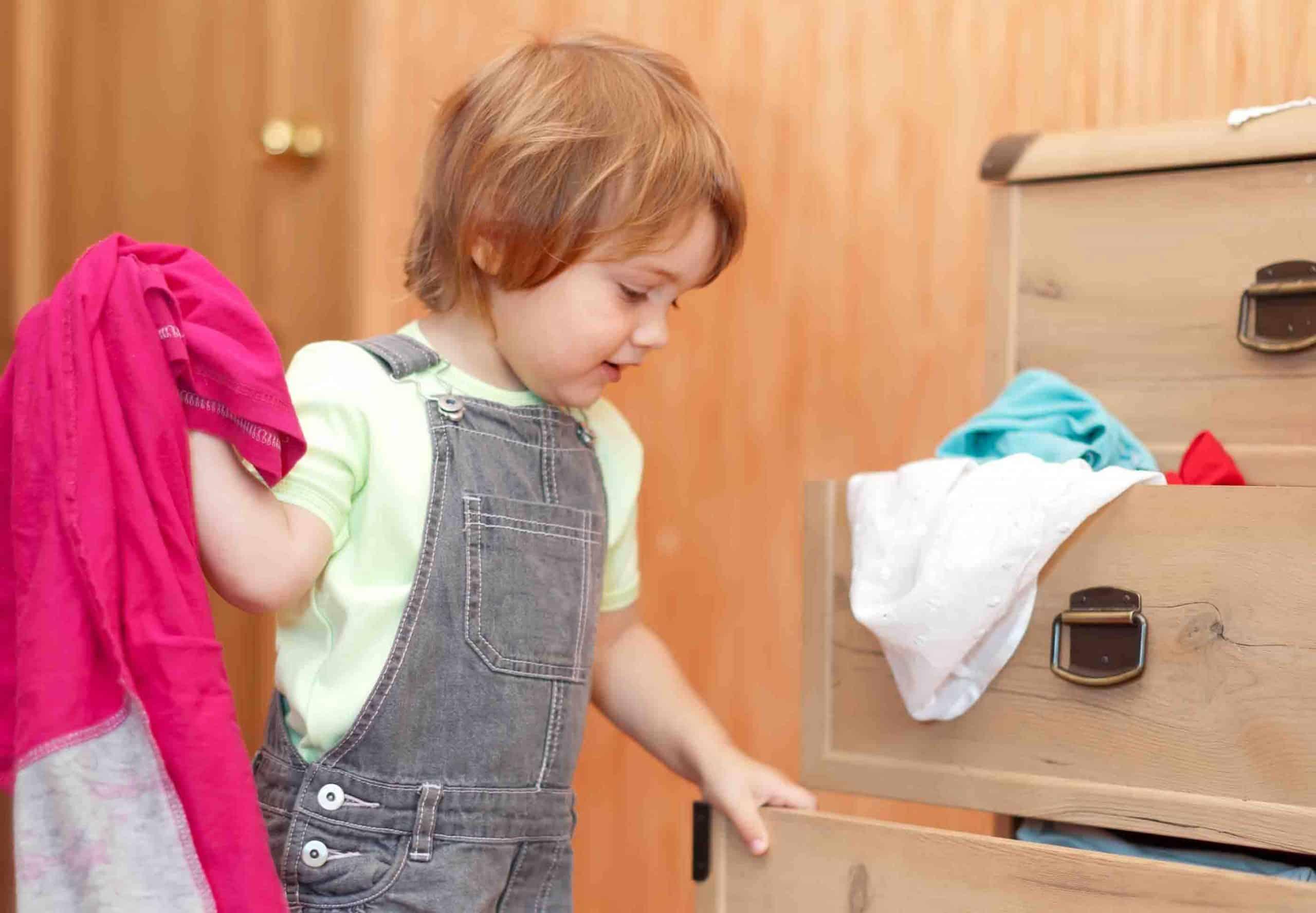 little boy fixing drawer