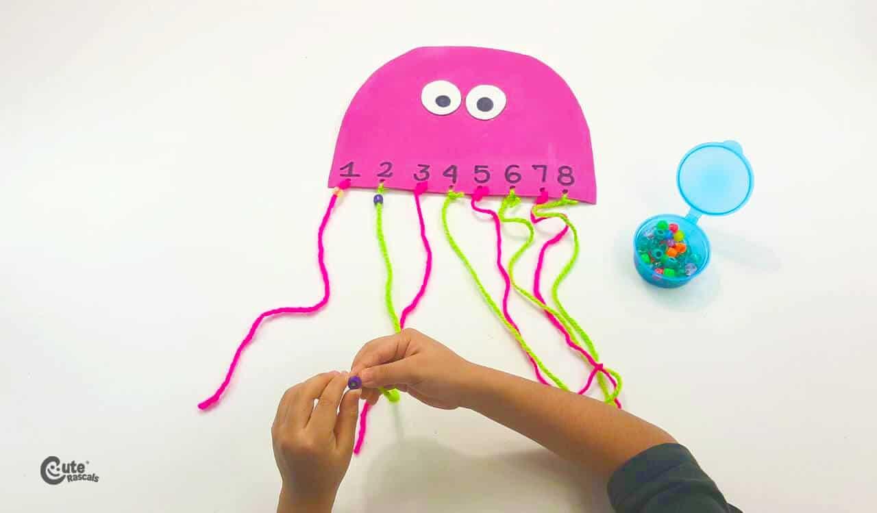 Introduce the beads onto the yarn